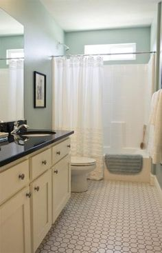 Benjamin Moore – Wythe Blue - might hide the almondy-ness of the fixtures in the 2nd floor bath