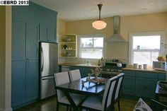 1924 Oakland Arts & Crafts duplex - kitchen with blue cabinets and butcher block counter tops