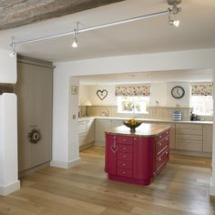 Painted kitchen in Farrow & Ball Oxford Stone, larder in Lindon Stone and Raspberry Pink island by Intone Designs