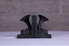 Bookends add character to a collection while also serving a very practical role in keeping the shelf all neat and tidy.