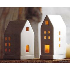 Roost Porcelain Tealight Houses. With their sleek silhouettes, our clean-lined houses have an urban attitude. Each design is priced individually, but can be grouped to create a village of light. Each set includes one of each of the three designs.