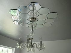 Use mini mirrors on the ceiling around a chandelier. Or maybe on the wall around a picture/clock!