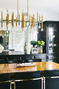 An Elevated Dining Room With A Statement Chandelier