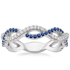 Alternating strands of diamonds and sapphires twist together to form a stunning infinity pattern, making this luxurious ring perfect for any special occasion. A small sizing bar in back allows for future adjustments (approx. 0.20 total carat weight).
