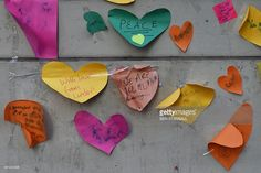 Tributes to the victims of the attack on the Paris offices of satirical weekly Charlie Hebdo are seen outside the French embassy in London on January 9, 2015.