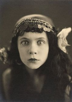 Talk about an eye-catching image! I don't know anything about this photo except that it dates from the 1920s, so I don't know who this girl is or what the photo is from, but you can't help but stare back can you?!? Isn't she lovely?