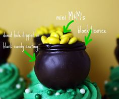 pot o gold cupcakes: donut hole dipped in black candy coating, black licorice and yellow m&ms