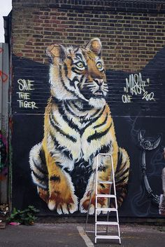 Save the Tiger, Brick Lane. Cool street art and graffiti.