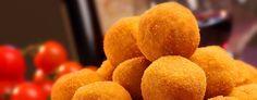 L'arancino (in siciliano arancinu o arancina) è una specialità della cucina siciliana. Si tratta di una palla o di un cono di riso impanato e fritto, del diametro di 8-10 cm, farcito generalmente con ragù, piselli e caciocavallo, oppure dadini di prosciutto cotto e mozzarella. Il nome deriva dalla forma originale e dal colore dorato tipico, che ricordano un'arancia, ma va detto che nella Sicilia orientale gli arancini hanno più spesso una forma conica.
