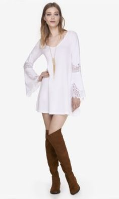 WHITE LACE INSET TRAPEZE DRESS from EXPRESS. I like the tall boots with this.