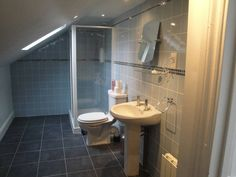 En-suite bathroom in your own private loft. Photo: Lynne Howard