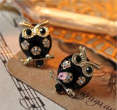 Add elegance to your style with these Black and Gold Owl Earrings!