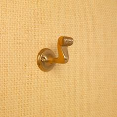 The Rateau Hook - Brass – Pinxton & Co Brickwork, Art Deco Design, Home Accessories, Plugs, Door Handles, Elephant, Bronze, Brass, Silver