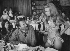 """""""Hi, I'm Raquel. I'll be your server today."""" During filming of One Million Years B.C. Raquel Welch. 1966."""