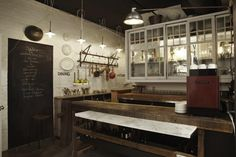 A Restaurant Inspired by Blacksmiths : Remodelista: the white brick, chalkboard, rustic repurposed wood, labeling on the cupboards; most things about this kitchen are on point for my own with the addition of a few splashes of color from artwork and flowers of course.