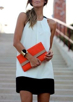 white and black shift dress, orange clutch, cuff bracelet