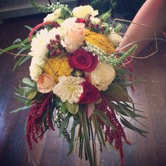 Dahlias, roses, red hanging amaranthus, yarrow, and some beautiful greenery makes for a beautiful bouquet! Only at Willow Specialty Florist! #weddingflowers #willowspecialty #utahweddings