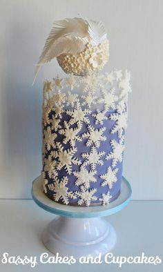 Exactly what is happening here? Snowflake Birthday - Cake by Sassy Cakes and Cupcakes (Anna)