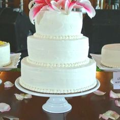 whitcomb/powell wedding cake - five flavored pound cake (almond, lemon, orange, rum and vanilla) layered and topped with almond and vanilla buttercream and stargazers