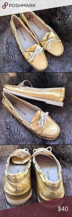 """Michael Kors gold boat shoes Michael Kors Blair metallic gold leather loafer with ivory white leather tie. The footbed is a comfy cushioned leather.  1/2"""" heel. New with box.  There is a price tag but will be removed prior to shipping. Michael Kors Shoes Flats & Loafers"""