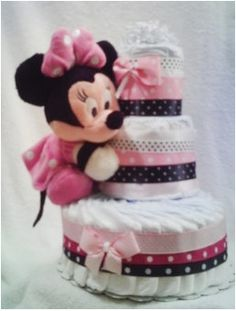 Disney Minnie Mouse Diaper Cake   http://diapercakesbylatersa.com/zencart/index.php?main_page=product_info&cPath=1_3&products_id=16