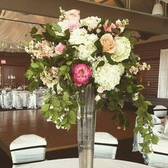 Dripping jasmine vine with coral charm peonies and hydrangea