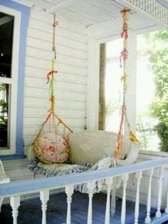 Old wicker couch as porch swing.