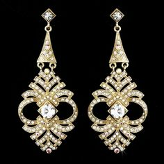 """Gold plating dazzles throughout these beautiful earrings, accented by clear rhinestones. A versatile pair that can be worn to your modern or vintage-inspired wedding, prom, or homecoming. The earrings fall to a lovely 2 7/8""""."""