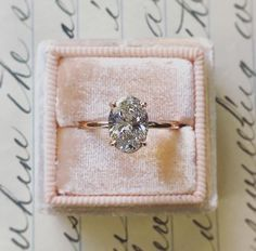 diamond oval cut engagement / wedding ring with rose gold band
