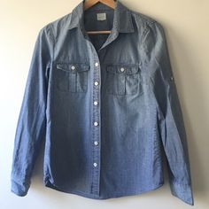 J.Crew denim shirt No trades! Worn a couple of times. Size xs. True to size! No stains/holes/rips. Great condition. Make an offer✨ J. Crew Tops