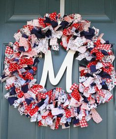 18 Inch Memorial Day or 4th Of July Frayed Fabric by HanginRound, $28.00--This item is no longer available, but you should be able to figure it out and make one yourself out of pieces of fabric and a wreath frame.