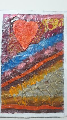 Created on this year's Gay Pride day, I started using dark brown tissue shoe wrapping tissue paper and a paper napkin which I wrinkled and painted with acrylic  paints, silver and golden inks. the heart was made with  cardboard and wrinkled baby wipes. Recycled cardboard and paper.