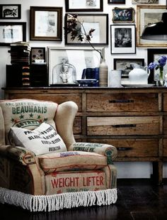 Shabby chic old sack covered chair. Lots of framed pictures. A lived in and loved look.
