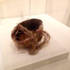 Lena Yarinkura's 1985 Bush string basket made using ochre, egret feathers, cocky apple tree bark fibres and kurrajong string at MCA, Sydney