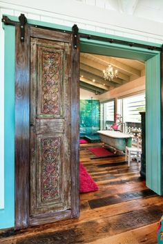 """Sliding """"barn"""" doors are very popular and this one offers a rustic hacienda feel.planned for my craft room doors. Style At Home, Style Hacienda, Future House, My House, House Front, Tiny Homes, New Homes, Eclectic Bathroom, Boho Bathroom"""