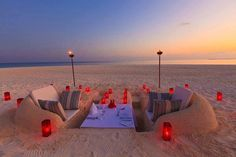 beach wedding seating made of sand and cushions