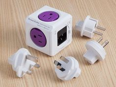 PowerCube: Single Outlet Travel Adapter - 2 USB Ports, 4 Sockets + 4 Travel Adapter Plugs