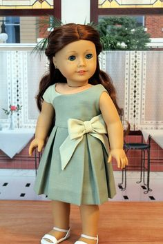 Sage Green Linen Dress in two shades of green, with pleated skirt and bow embellishment, MV pattern. $45.00, by BabiesArtUs via Etsy.