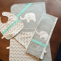 $35. This is a custom order three-piece bib, blanket, and burp cloth in soft flannel and cotton. Elephant appliqués. OliviaLawsonDesigns.etsy.com