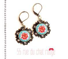 boucles d'oreilles Rose aux petits pois bleu pastel cabochon 12 mm finition bronze : Boucles d'oreille par arbremagic