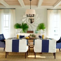 Show Stopping Oar Paddle Mirror in a Nautical Tropical Living Room: http://www.completely-coastal.com/2016/03/oar-paddle-mirror.html
