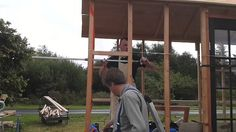 Anselm shows how to strenghen the walls on the by inserting cross batons between the uprights. Shepherds Hut, Douglas Fir, Walls