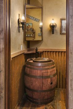 Traditional Mountain Rustic custom home with an old oak barrel sink and corrugated metal siding accents in this bathroom designed by Kogan Builders, Inc. of Durango, CO Barrel Sink Bathroom, Rustic Bathroom Sinks, Rustic Bathroom Designs, Primitive Bathrooms, Bathroom Ideas, Bathroom Cabinets, Bathroom Vanities, Bathroom Storage, Men's Bathroom