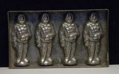 Antique-flat-chocolate-mold-of-four-polar-explorer-by-Riecke-Co