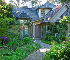Perfect  English  Cottage | love the potted pansies by the door and the white wisteria. Globe ...