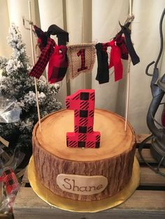 Check out the awesome logo birthday cake at this Little Lumberjack Birthday Party!! See more party ideas and share yours at CatchMyParty.com #lumberjack #1stbirthday #cake