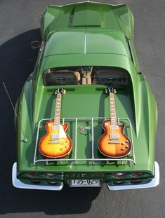 Classic Cars: Green Corvette with Les Paul guitars, Rock & Roll! Classic all the way.