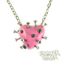 Baby Pink Broken Heart Necklace With Screws (goth, pastel, rave, jewellery, punk, emo, industrial, indie, Lolita, Cyber, kawaii). $34.99, via Etsy.