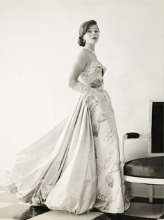 Eleanor Lambert in a gown designed by James Galanos, 1950s