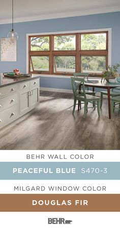 With large open windows and an oversized island, this kitchen is full of style. Want to know how you can create this calming look in your home? Start with a new coat of Behr Paint in Peaceful Blue paired with these Essence Series® Picture & Awning wood windows, by Milgard, in Douglas Fir. Click below for full paint color details to learn more.